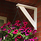 Instead of throwing those extra brackets away use them to decorate your home for either a hanging basket or bird feeder!